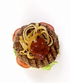 Hamburger with tomatoes, ketchup and onions