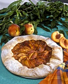 Peach tart with folded edge; fresh peaches