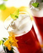 Raspberry jelly with cream and lemon balm