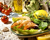 Shrimps with olives, herbs and lemon on bed of lettuce