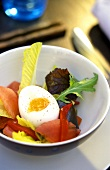 Soft egg with lettuce and fish