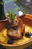Lamb shank with plums and apricots in curry sauce