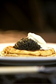 Blini with black caviare and sour cream