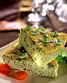 Basil flan with cherry tomatoes