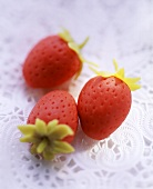 Marzipan strawberries on doily