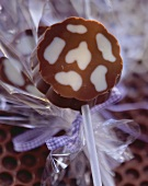 Two-colour (cow markings) chocolates with paper sticks