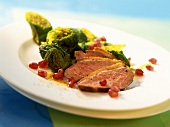 Duck and savoy salad with pomegranate seeds