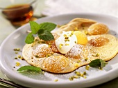 Mirabelle pancake with blob of yoghurt and pistachios