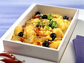 Spicy sweetcorn and potato bake with olives and chili