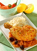 Chicken leg with tomatoes, olives and rice