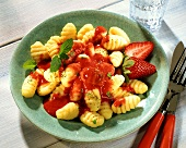 Gnocchi with strawberry sauce and mint leaves