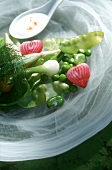Spring vegetables and a spoonful of yoghurt sauce