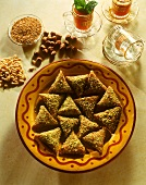 Tunisian puff pastry nut triangles with chopped pistachios