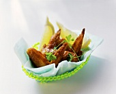 Chicken wings with lemon wedges and parsley