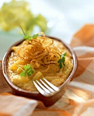 Cheese noodles (spaetzle) with fried onions and parsley