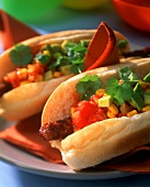 Mexican style hot dogs with chorizo, sweetcorn and avocado