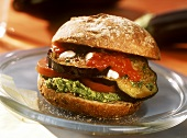 Vegetable burger with aubergines, tomatoes & herb paste