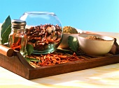 Dried chili peppers, chili powder and spices in bowls