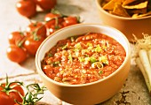 Cooked tomato salsa with spring onions