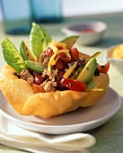 Mexican mince salad in tortilla basket