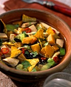Mexican chicken stew with pumpkin and tortilla chips