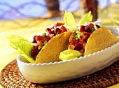 Taco shells with chicken filling and romaine lettuce
