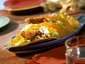 Taco shells with fried plaice and caper sauce