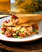 Taco shells with coriander shrimps & tomato & avocado salad