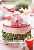 Strawberry yoghurt cake with pistachios & flower decoration