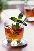 Strawberry punch with sprig of mint in glass