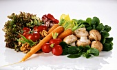 Vegetable still life with lettuce, mushrooms & walnut kernels