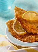 Chicken breast with parmesan crust and lemons