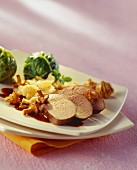 Wild boar medallions with chanterelles, mash & cabbage