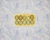 Pheasant's eggs on wood shavings in bowl