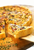 Tart with Provencal vegetables on wooden plate