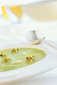 Lettuce soup with sour cream and croutons