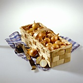 Onions in chip basket on blue checked cloth