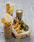 Fish and chips with mustard dip and spring onions