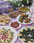 Swedish summer buffet with salads, meat and rolls
