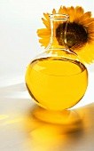 Sunflower oil in front of sunflower