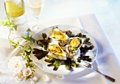 Baked oysters and white wine, in atmospheric setting