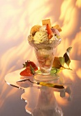 Mixed ice cream sundae with fruit and cream
