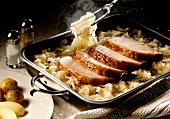Smoked pork rib with sauerkraut in roasting dish