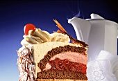 Piece of Black Forest cherry gateau; coffee pot