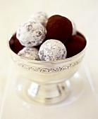 Marzipan balls with icing sugar and cocoa powder