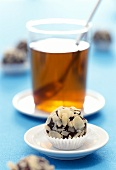 Zwieback (rusk) chocolates with flaked almonds; tea