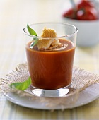 Tomato soup with zwieback (rusk) in glass