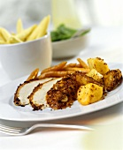Chicken breast with mustard crust and potatoes