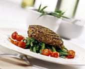 Peppered steak on green beans with cherry tomatoes
