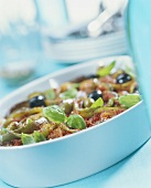 Vegetable casserole with olives and basil